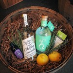 Wooden basket with an assortment of Wigle Whiskey products