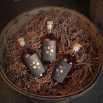 Basket with three mystery bottles from Wigle Whiskey