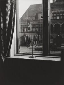 a-menorah-defies-the-nazi-flag-1931